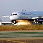 Photo of Jet Blue landing; via Gawker